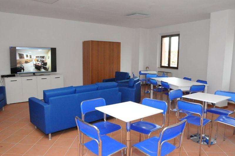 alloggi in sostituzione SAE presso Palazzo Magnalbò, Rotella: sala comune